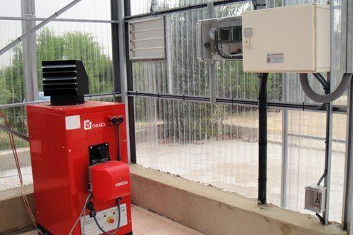 Generador de aire caliente en invernadero de investigación.